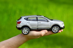 Hand with toy car Royalty Free Stock Photos