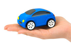 Hand and toy car. Isolated on white background Stock Photo