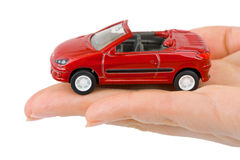 Hand and toy car Stock Photography