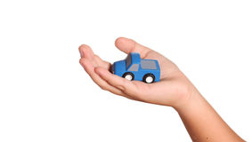 Hand and toy car isolated on white. Background Stock Photo