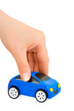 Hand and toy car. Isolated on white background Royalty Free Stock Image