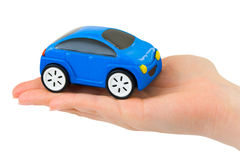 Hand and toy car. Isolated on white background Royalty Free Stock Images