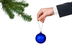 Hand with toy and Christmas tree Royalty Free Stock Photo
