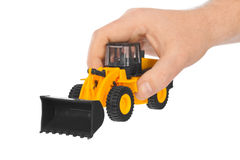 Hand with toy loader Royalty Free Stock Images