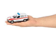 Hand with toy police car Royalty Free Stock Image
