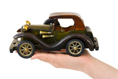 Hand and toy retro car Stock Photography