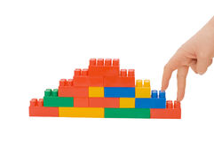 Hand and toy stairs Royalty Free Stock Image