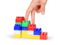 Hand and toy stairs Stock Image