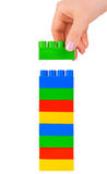 Hand and toy tower stock images