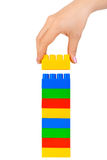 Hand and toy tower Stock Image