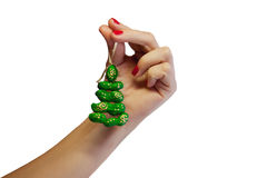 Hand with toy tree Royalty Free Stock Image