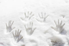 Hand tracks in the snow. Human tracks in the snows royalty free stock photo