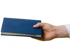 Hand transferring a notebook. Royalty Free Stock Image