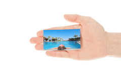 Hand and a travel card Royalty Free Stock Photos