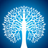 Hand tree in blue background Royalty Free Stock Photography