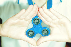 Hand triangle with a spinner Royalty Free Stock Photo