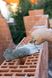 Hand and trowel Royalty Free Stock Images