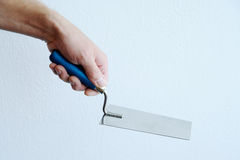 Hand with trowel Royalty Free Stock Photos