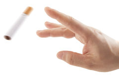 Hand trowing cigarette Quit smoking metaphor Stock Images