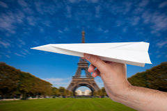 Hand trowing a paper plane in Paris Stock Image
