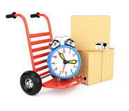 Hand truck with alarm clock and carton boxes Royalty Free Stock Photos