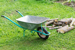 Hand truck with firewood on the  grass Stock Photos