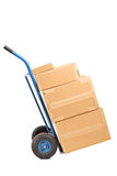Hand truck full of boxes. Hand truck full of carton boxes isolated on white background Royalty Free Stock Image