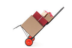 Hand Truck with Gift Boxes. Hand truck - dolly with several gift boxes isolated on white Royalty Free Stock Photos