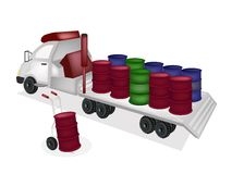 Hand Truck Loading Oil Barrels into Tractor Traile Stock Photography