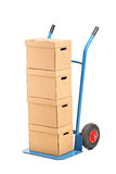 A hand truck with many boxes on it Stock Photos