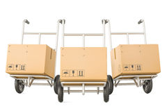 Hand trucks with parcels, shipping and delivery concept. 3D rend Royalty Free Stock Photo