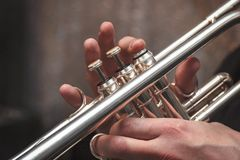 Hand of the Trumpeter on the buttons of trumpet. Hand of the Trumpeter on the buttons of the trumpet Royalty Free Stock Photography
