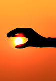 Hand try to touch the sun Royalty Free Stock Photos