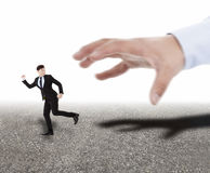 hand trying to catch running businessman Stock Photography