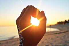 Hand trying to catch the sun royalty free stock photography