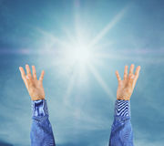 Hand trying to reach on the sky with sunshine rays. Hand trying to reach on the sky with sunshine ray Stock Photography