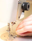 Hand is trying to thread the needle of a sewing machine Royalty Free Stock Photography