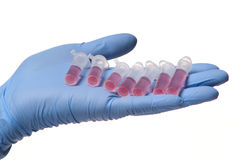 Hand with tube. Human hand with eppendorf tubes. White background. Studio shot royalty free stock photos