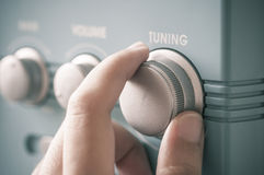 Hand tuning fm radio. Button. Retro image processed Stock Images
