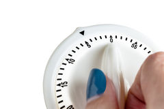 Hand tuning white button, button switch time scale on white back Stock Image