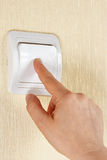 Hand turn off the light switch on the wall. Hand turn off the light switch on wall royalty free stock photo