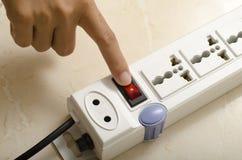 Hand turn on switch multiple  socket plug Royalty Free Stock Image
