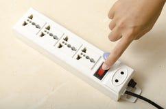 Hand turn on switch multiple  socket plug Stock Photos