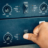 Hand turn on switch power amplifier Royalty Free Stock Image