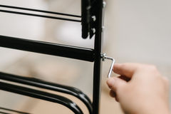 Hand turning Allen key in diy furniture Stock Photos