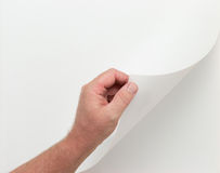 Hand Turning Blank Page with Clipping Paths. Male Hand Turning Blank Page - Contains Clipping Paths To Add Your Own Images or Text stock image