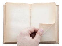 Hand turning book page Stock Image