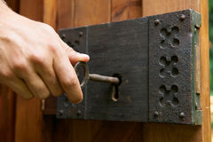 Hand Turning Key In Old Fashioned Lock Stock Image