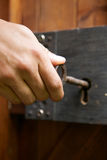 Hand Turning Key In Old Fashioned Lock Royalty Free Stock Photography
