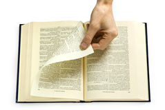 Hand turning  page Royalty Free Stock Images